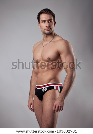 Handsome powerful muscular man - stock photo