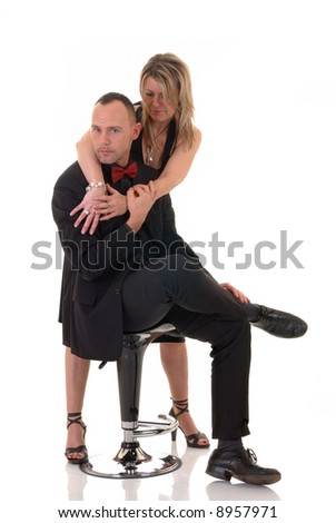 Handsome pre middle aged male gigolo in formal suit with attractive female admirer, white background,  studio shot.