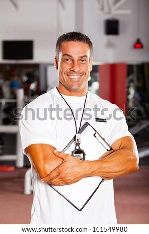 handsome professional gym instructor portrait