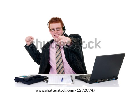 Handsome red-headed smiling young male secretary, help desk assistant with headset. White background, studio shot.
