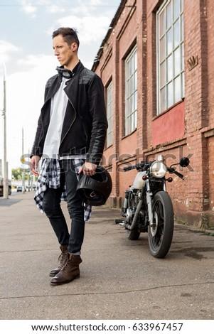 handsome rider biker man in...