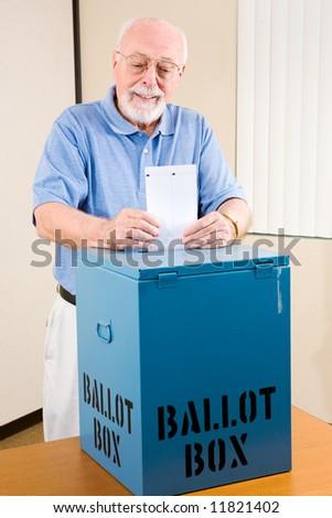 Handsome senior man casting his ballot at the polls.