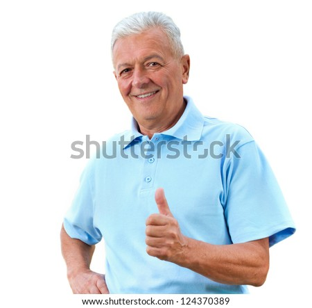 Handsome senior man in bright polo-shirt shows thumb up.