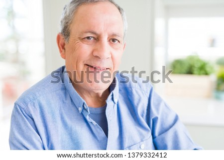Handsome senior man smiling confident