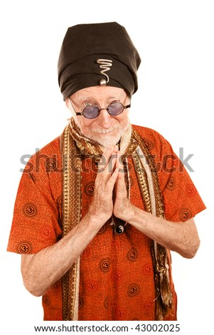 Handsome senior new age man giving blessing with hands clasped
