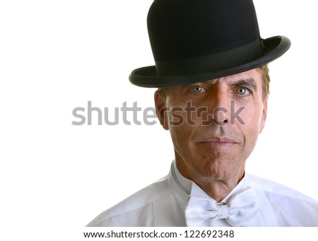 Handsome serious man with green eyes wearing a white formal shirt and a black bowler hat