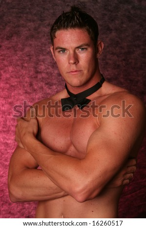 stock photo : Handsome sexy male gigolo stripper Studio shot with black bow ...