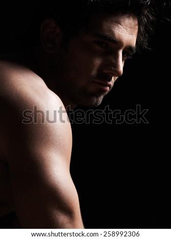 handsome  sexy topless macho man portrait topless muscular in studio black background
