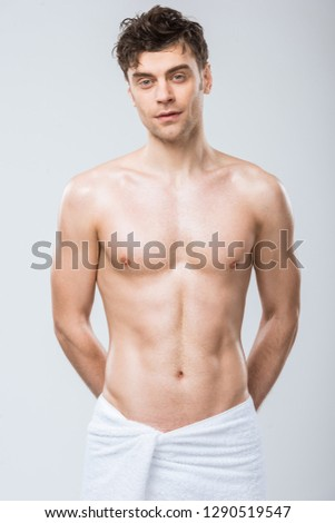 handsome shirtless man man with muscular torso isolated on grey