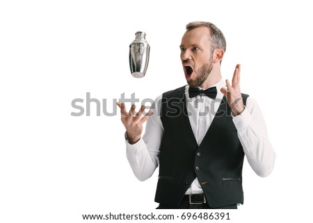 handsome shoked bartender looking at flying shaker isolated on white #696486391