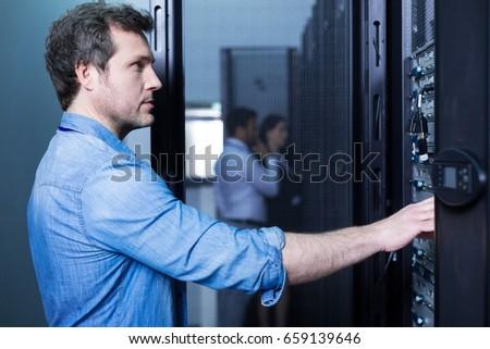Handsome smart man doing his job #659139646