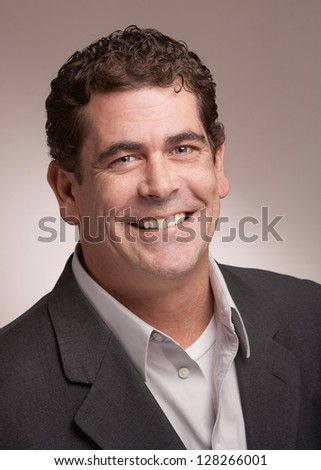 Handsome smiling business man portrait - stock photo