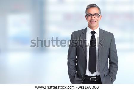 Handsome smiling businessman over blue banner background. Сток-фото ©