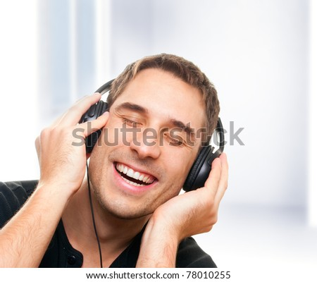 handsome smiling man listening the music.