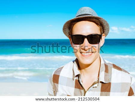 Handsome smiling man on the beach