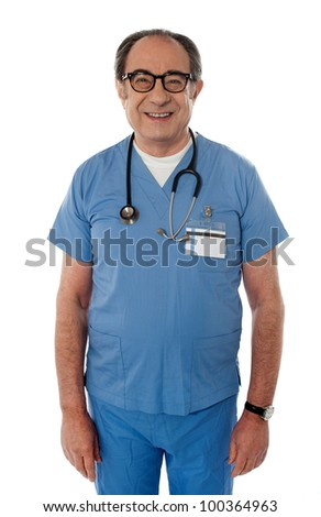 Handsome smiling senior doctor with stethoscope around his neck posing in front of camera