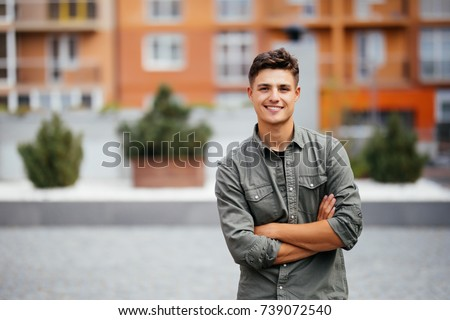Handsome smiling young man portrait. Cheerful men looking at camera #739072540