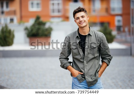 Handsome smiling young man portrait. Cheerful men looking at camera #739754449