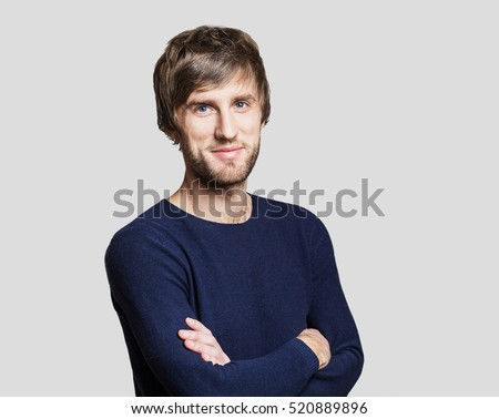 Stock Photo Handsome smiling young man studio portrait