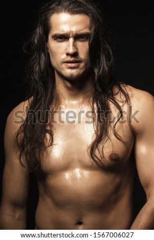 Handsome sport masculed sexy stripped guy  with white towel on isolated black background font