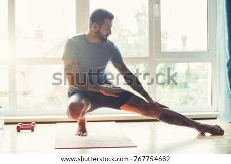 handsome sporty man doing exercise at home #767754682