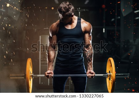 Handsome strong athletic fitness men pumping up arm muscles workout barbell curl fitness concept background - muscular bodybuilder men doing bodybuilding biceps exercises in gym naked torso