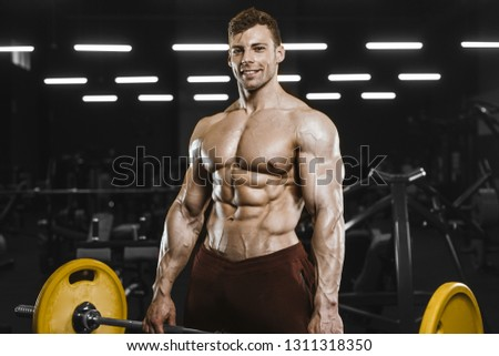 9bab7dcc5db Handsome strong athletic men pumping up muscles workout bodybuilding  concept background - muscular bodybuilder handsome men