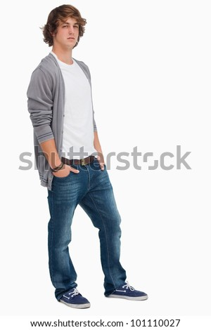 Handsome student posing hands in pockets against white background