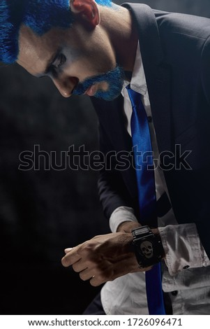 Handsome stylish bearded man. Men's beauty, fashion. Male beard and mustache. Sexy male, macho, long beard. Studio portrait of a bearded hipster man. Bearded man in suit and bow-tie A man's blue beard