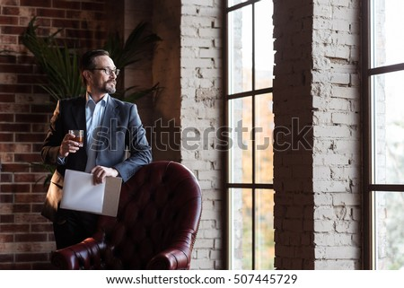 Handsome stylish businessman looking into the window #507445729