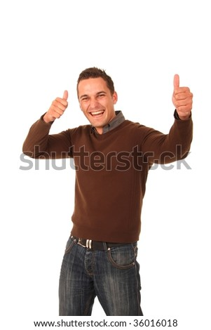 Handsome stylish young man with thumbs up and big grin
