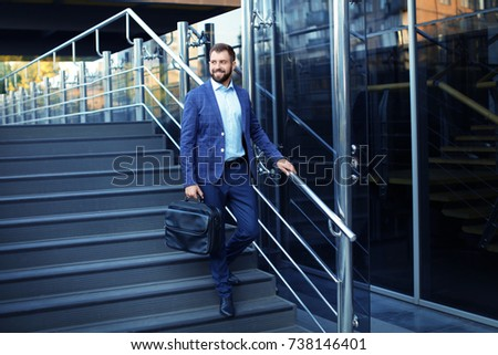 Handsome successful businessman outdoors #738146401