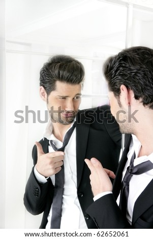 Handsome suit proud young man humor funny gesturing in a mirror