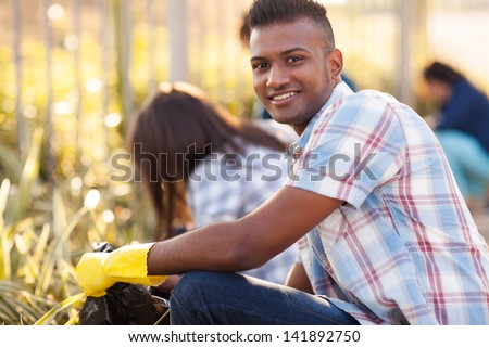 handsome teen volunteer cleaning streets with friends #141892750
