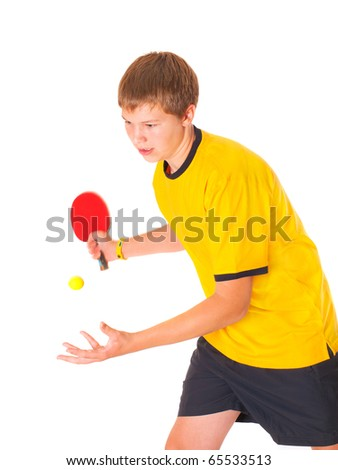 Handsome teenage in yellow T-shirt playing ping-pong