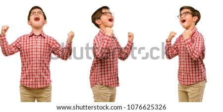 Handsome toddler child with green eyes happy and excited expressing winning gesture. Successful and celebrating victory, triumphant