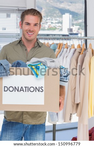 Handsome volunteer holding donation box