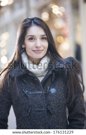 handsome woman portrait with city lights in background