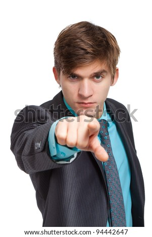 Handsome young angry business man point finger at you, businessman serious looking at camera, isolated over white background