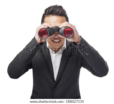 handsome young asian man looking trough a binoculars