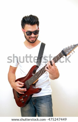 Handsome Young Asian Men Playing Guitarselective On Hand Blurry And Soft Focus