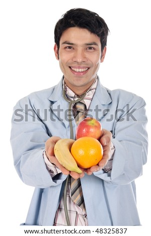 Handsome young  Asian Nepalese doctor showing handful of fruit.  Studio white background