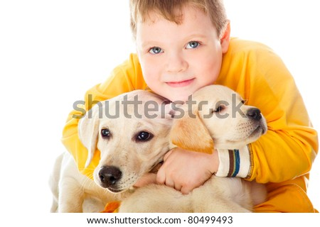 Handsome Young Boy Playing with His Two Dogs Against White Background