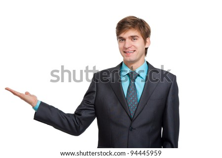 Handsome young business man happy smile, businessman showing something on the open palm, concept of advertisement product, empty copy space wear elegant suit and tie isolated over white background