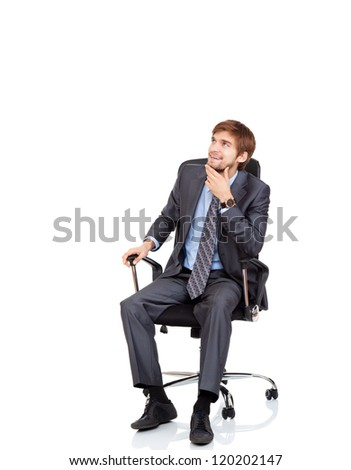 Handsome young business man happy smile look up to empty copy space sitting in chair, businessman think, idea, hold hand finger on chin wear elegant suit and tie isolated over white background