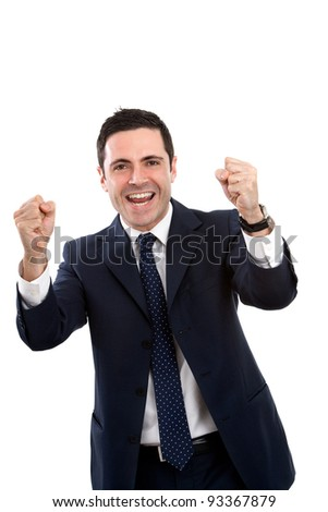 Handsome young business man in blue suit expressing a cry for victory. Isolated on white.