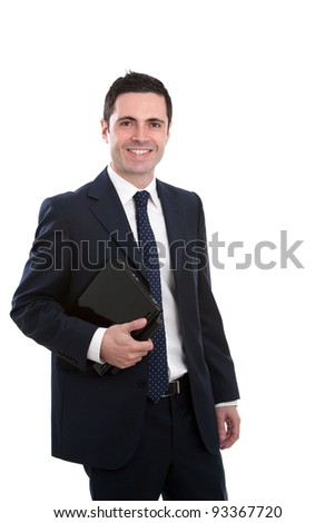 Handsome young business man in blue suit holding laptop. Isolated on white.