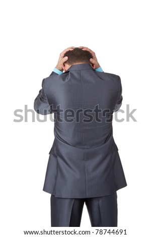 Handsome young business man in modern elegant suit standing back holding head with his hands, isolated over white background. Concept of neck or head ache, pain, problem, tired up.