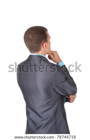 Handsome young business man in modern elegant suit standing back, isolated over white background. Concept of idea, ask question, think up, choose, decide,