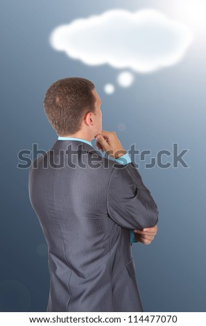 Handsome young business man in modern elegant suit standing back looking at drawing cloud with empty copy space, isolated over white background. Concept of idea, ask question, think up, choose, decide